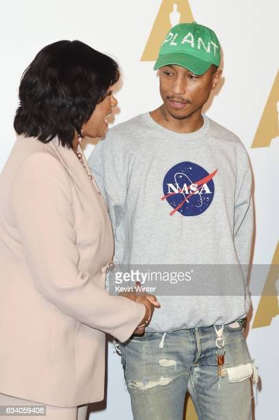 President Cheryl Boone Isaacs and actor Musician/producer Pharrell Williams attend the 89th Annual Academy Awards Nominee Luncheon at The Beverly...