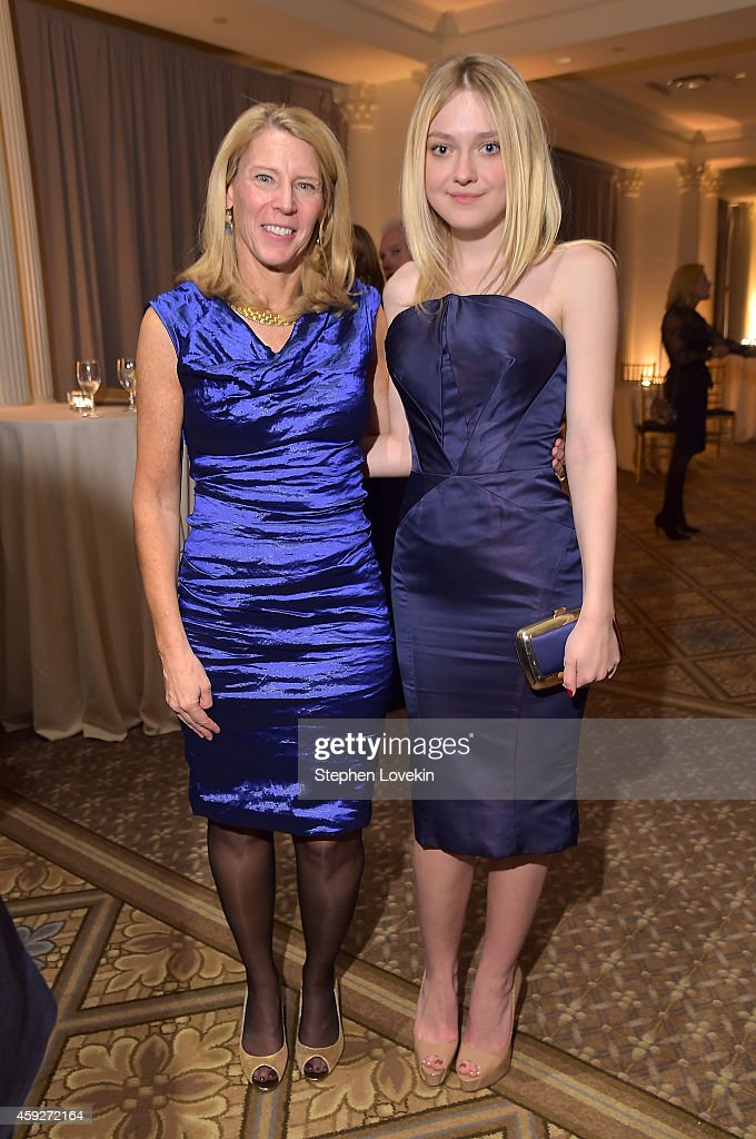 President & Chief Executive Officer for Save the Children Carolyn Miles (L) and actress Dakota Fanning attend the 2nd Annual Save The Children Illumination Gala at the Plaza on November 19, 2014 in New York City.