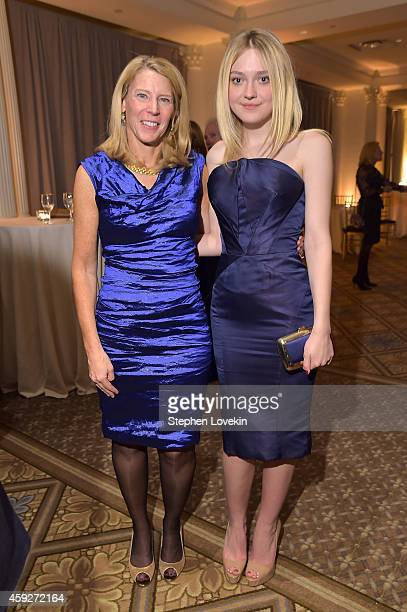 President Chief Executive Officer for Save the Children Carolyn Miles and actress Dakota Fanning attend the 2nd Annual Save The Children Illumination...