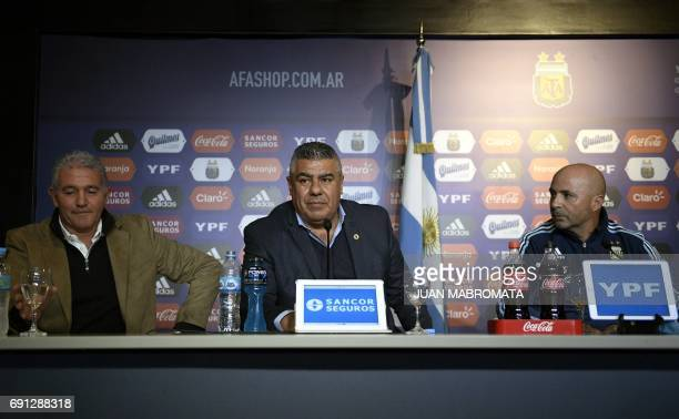 AFA president Claudio Tapia presents Argentine football team's new coach Jorge Sampaoli and manager Jorge Burruchaga during a press conference in...