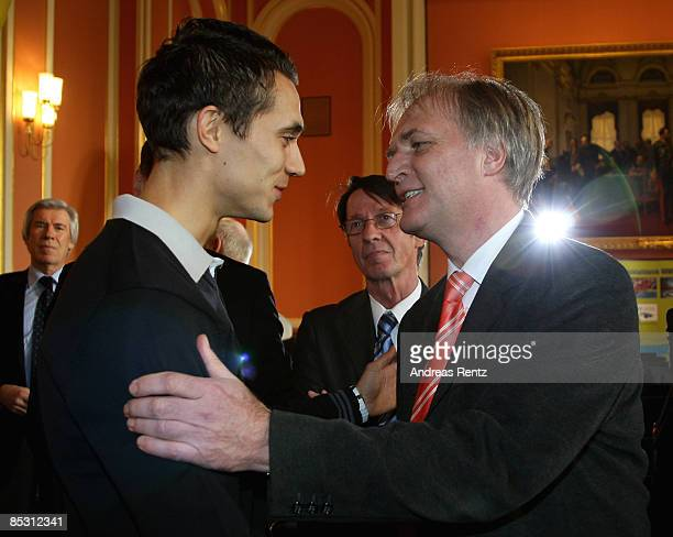 president Clemens Prokop welcomes Sebastian Bayer Gold medal winner Mens Long Jump at European Athletics Indoor Championships in Torino 2009 during a...