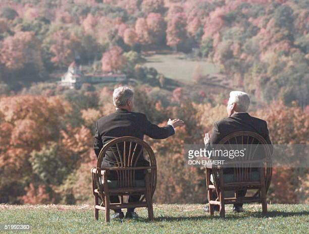 President Clinton and Russian Federation President Boris Yeltsin look at the fall foliage out over the Hudson River valley 23 October during their...