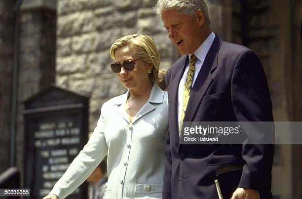 President Clinton and wife Hillary leaving church during their visit to Appalachia