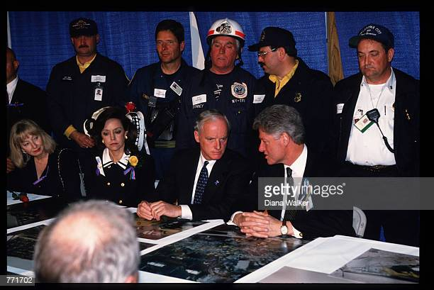 President Clinton discusses search and rescue details with Oklahoma Governor Keating as Keating's wife Cathy Lieutenant Governor Fallin and emergency...