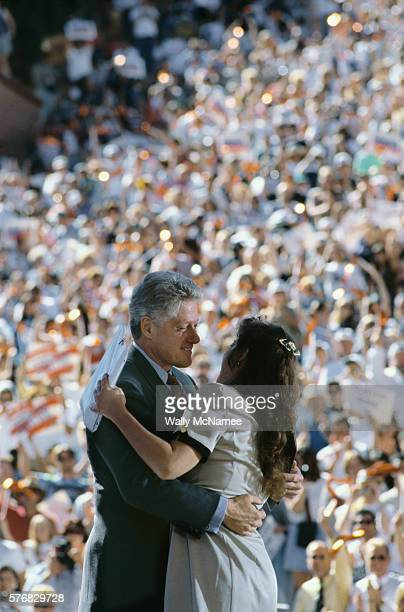 President Clinton hugs a Colorado supporter who just introduced him at Red Rocks Amphitheater during his 1996 presidential campaign