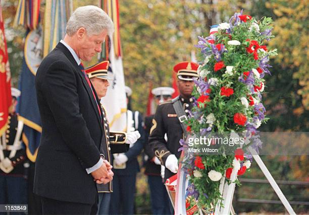President Clinton pauses after laying a wreath at the Tomb of the Unknown Soldier during the Veteran's Day Ceremony at Arlington Cemetery Va November...