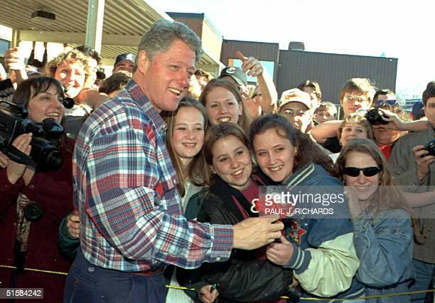 President Clinton poses with students from Woodland High School in Woodland Washington after surveying flood damage in southwestern Washington State...