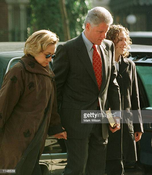 President Clinton wife Hillary along and daughter Chelsea arrive at the Foundry Methodist Church December 271998 in Washington DC The Clintons...
