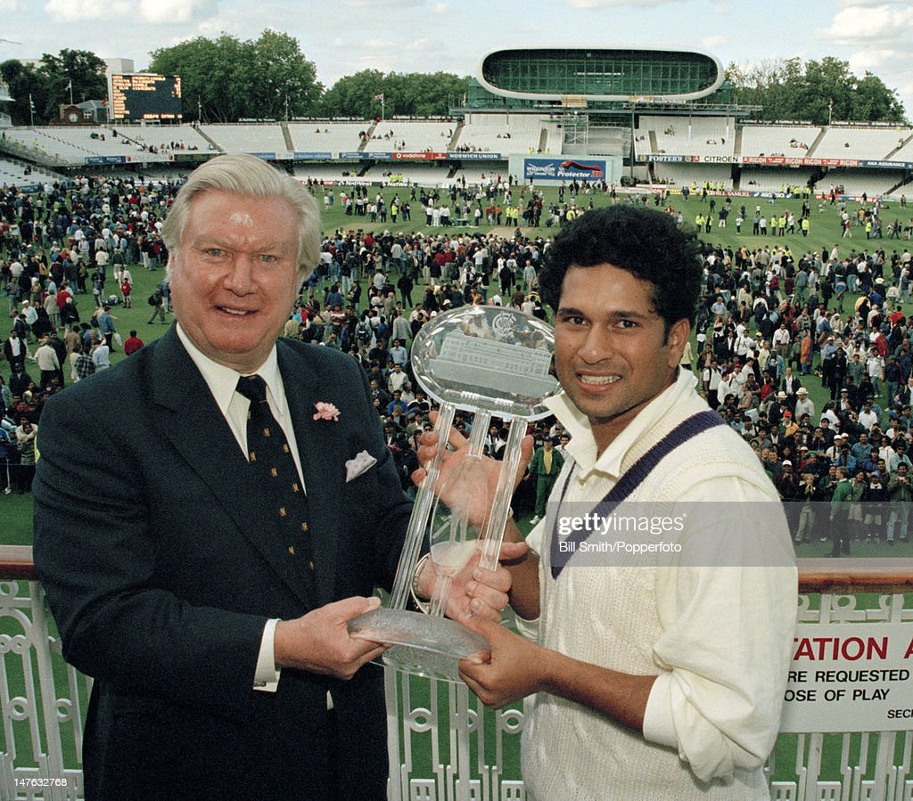 MCC President Colin Ingleby-Mackenzie (left) presents Sachin Tendulkar, captain of the The Rest of the World XI, with the WG Grace trophy after their victory in the Memorial match for Diana, Princess of Wales, between MCC and the Rest of the World XI at Lord's cricket ground in London, 18th July 1998. The Rest of the World XI won by by six wickets.