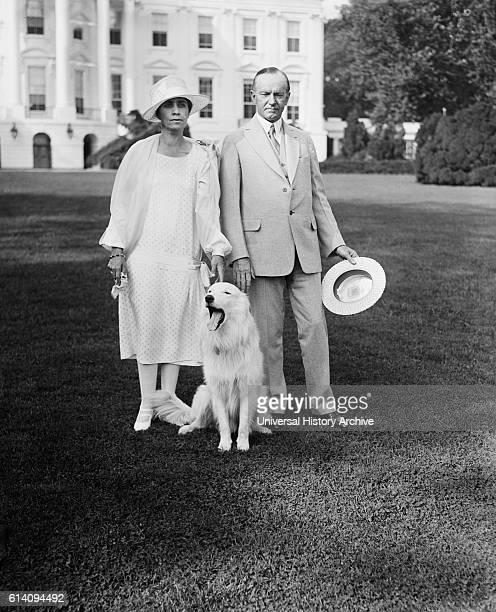 President Coolidge and Mrs. Coolidge with dog Outside White House, Washington DC, USA, circa 1927.