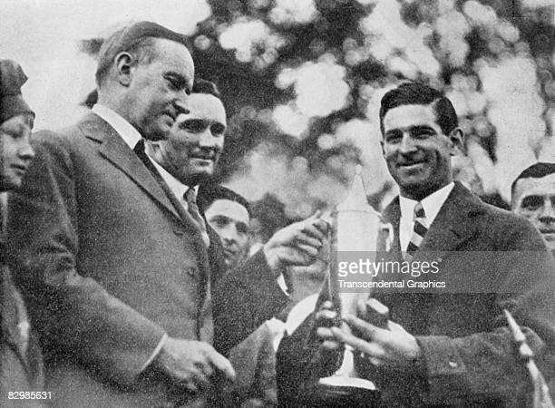 C SEPTEMBER 1924 President Coolidge presents Washington Senators manager Bucky Harris with the Citizens Cup for 1924 during a September ceremony in...