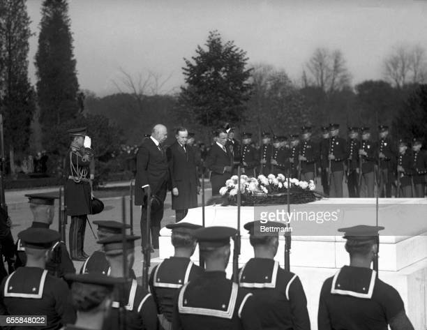 President Coolidge Secretary of War Weeks Assistant Secretary of Navy Roosevelt place wreath on the tomb of Unknown Soldier at the National Cemetary...