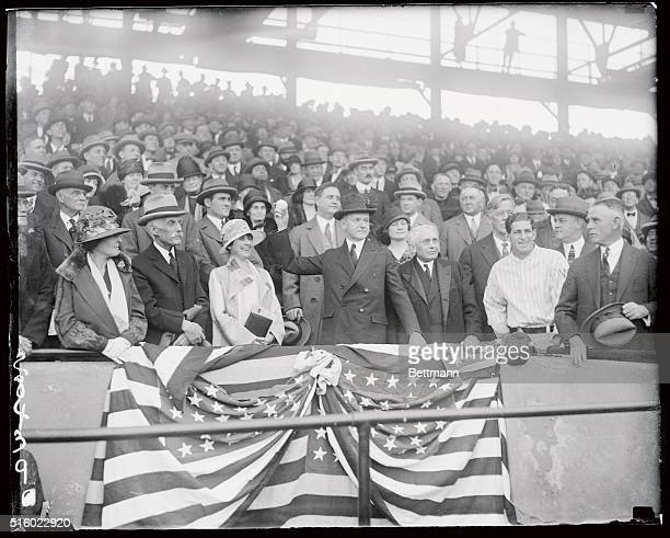President Coolidge throws out the 1st ball here to open the American League Baseball season in 1925