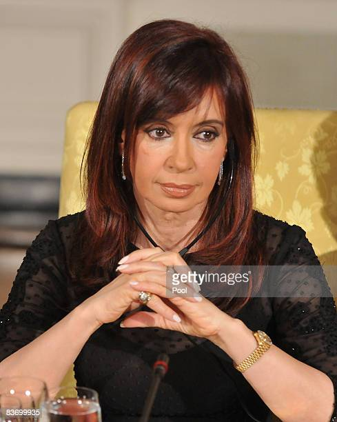 President Cristina Fernandez de Kirchner of Argentina listens as US President George W Bush gives remarks at a summit on financial markets and the...