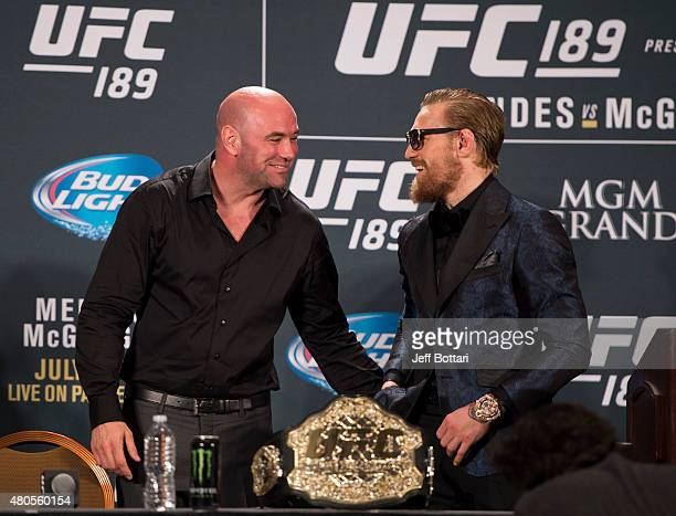 President Dana White and UFC interim featherweight champion Conor McGregor interact during the UFC 189 post fight press conference at the MGM Grand...