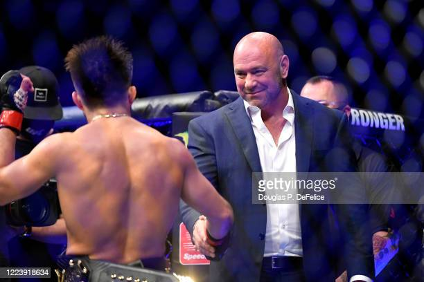 President Dana White congratulates Henry Cejudo of the United States after defeating Dominick Cruz of the United States in their bantamweight title...