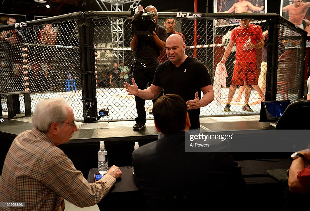 President Dana White interacts with the judges after the bout between team Edgar fighter Joseph Stephens and team Penn fighter Roger Zapata in their preliminary fight during filming of season nineteen of The Ultimate Fighter on November 8, 2013 in Las Vegas, Nevada.