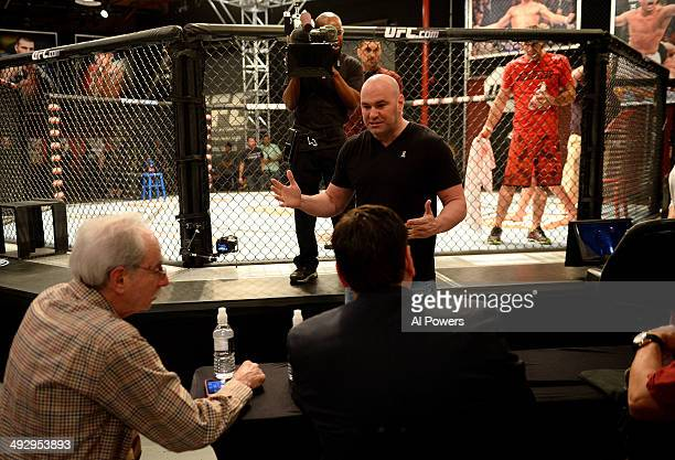 President Dana White interacts with the judges after the bout between team Edgar fighter Joseph Stephens and team Penn fighter Roger Zapata in their...