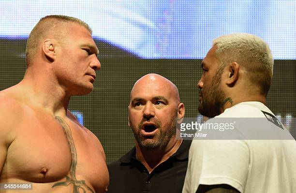 President Dana White looks on as mixed martial artists Brock Lesnar and Mark Hunt face off during their weighin for UFC 200 at TMobile Arena on July...
