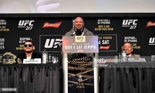 President Dana White moderates questions between fighters Michael Bisping of England and Georges StPierre of Canada during the UFC 217 Press...