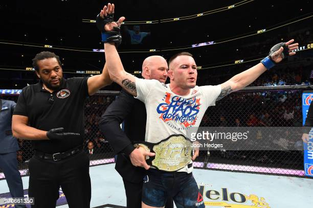 President Dana White places the interim welterweight championship belt on Colby Covington after defeating Rafael Dos Anjos of Brazil in their interim...
