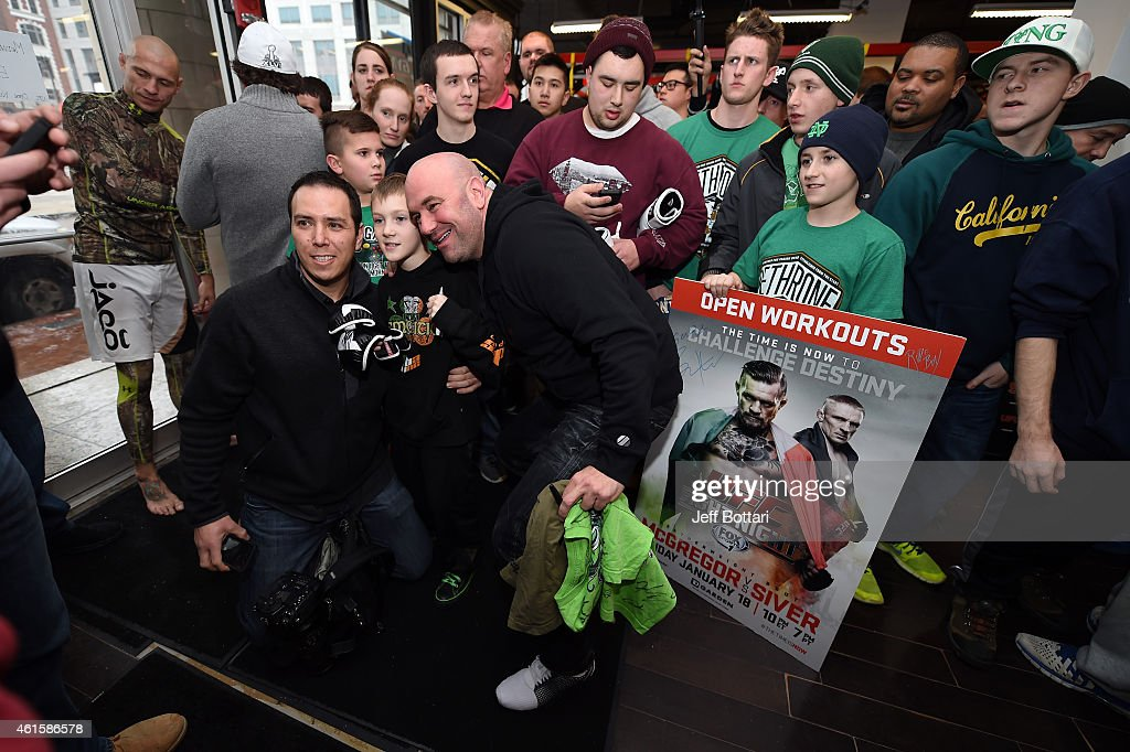 President Dana White poses with fans at the open training session for the media at UFC Gym on January 15, 2015 in Boston, Massachusetts.