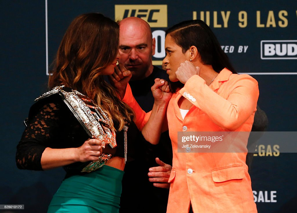 UFC president Dana White stands between Miesha Tate and Amanda Nunes as they square off during a media availability for UFC 200 at Madison Square Garden on April 27, 2016 in New York City.