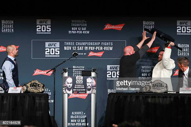 UFC president Dana White stops Conor McGregor from throwing a chair at Eddie Alvarez during the UFC 205 press conference at The Theater at Madison...