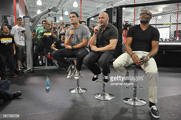 President Dana White talks along side Chris Weidman and mixed martial artist Anderson Silva of Brazil during a QA session at UFC Gym on September 23...