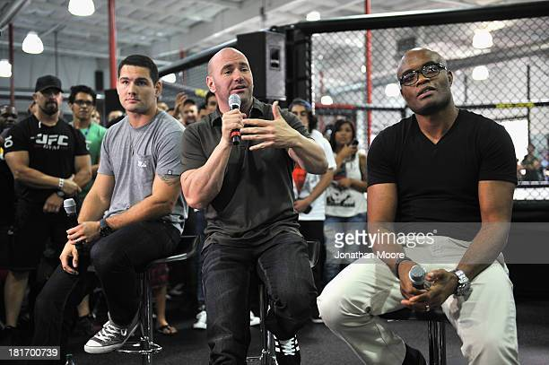 President Dana White talks along side mixed martial artist Chris Weidman of the United States and mixed martial artist Anderson Silva of Brazil...