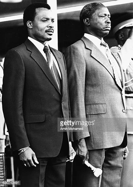 President Daniel arap Moi of Kenya and President Denis SassouNguesso of the Republic of Congo standing together at a meeting in Kenya circa 1980