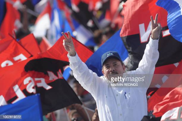 President Daniel Ortega waves to supporters as he arrives to take part in the commemoration of the 39th Anniversary of the Sandinista Revolution at...