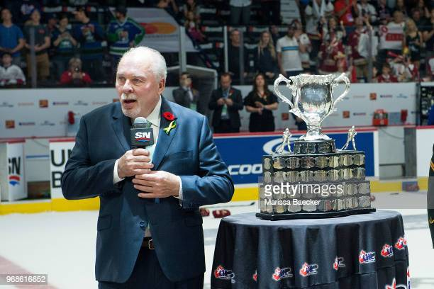 CHL president David Branch speaks to players on the ice prior to presenting the Memorial Cup trophy to the AcadieBathurst Titan after the win against...