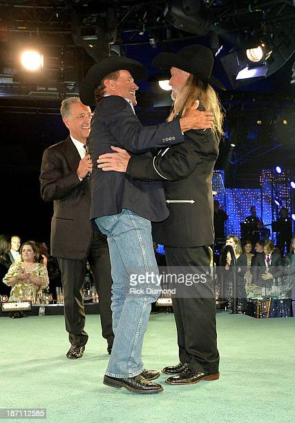BMI President Del Bryant and George Strait present the BMI Icon Award to songwriter Dean Dillon onstage during the 61st annual BMI Country Awards on...