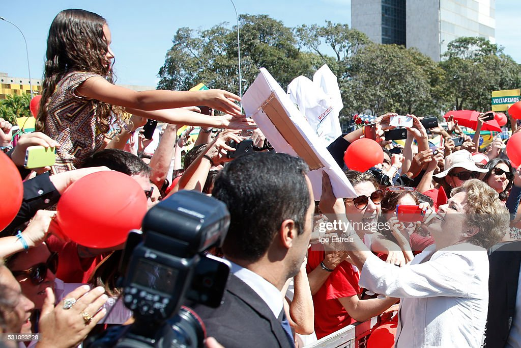 President Dilma Rousseff greets supporters while departing the Palacio do Planalto after the Senate voted to accept impeachment charges against Rousseff on May 12, 2016 in Brasilia, Brazil. Rousseff has been suspended from her presidential duties and will face a Senate trial for alleged manipulation of government accounts.