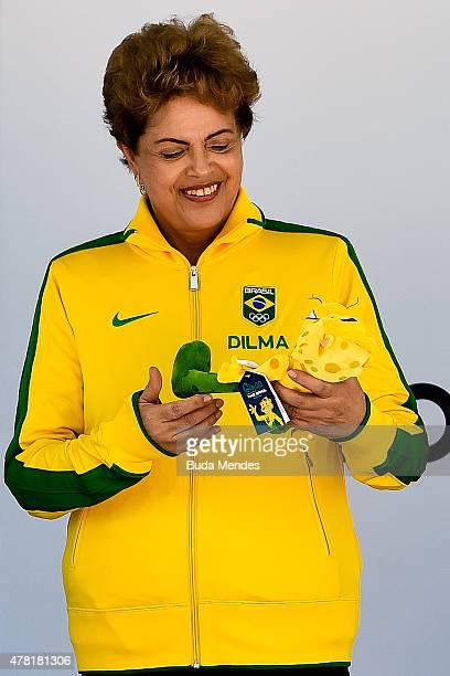 President Dilma Rousseff of Brazil holds a doll of Ginga, the Brazilian national Olympic team's new mascot, after being introduced by the Brazilian...