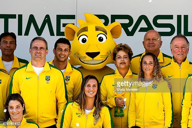 President Dilma Rousseff of Brazil poses with Ginga, the Brazilian national Olympic team's new mascot and Olympic team members after Ginga was...