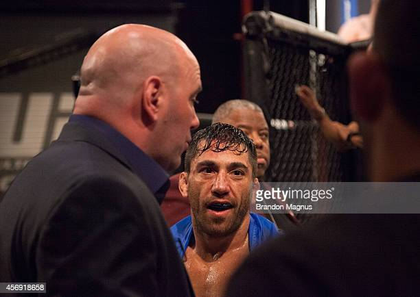 President discusses the results with Team Werdum after Team Werdum fighter Guido Cannetti's controversial loss to team Velasquez fighter Marco...