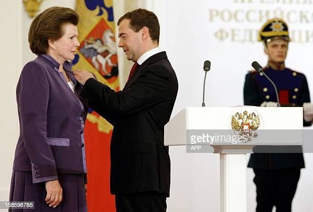 President Dmitry Medvedev fixes an award onto Valentina Tereshkova the first woman in space during Russia's State Awards ceremony at the Kremlin in...