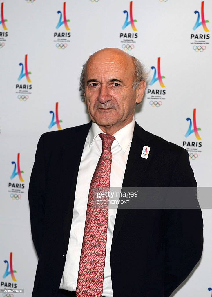 President Dominique Mahe poses prior to a meeting gathering French companies and official partners of Paris candidate for the 2024 Summer Olympic games on May 30, 2016 in Paris. / AFP / ERIC