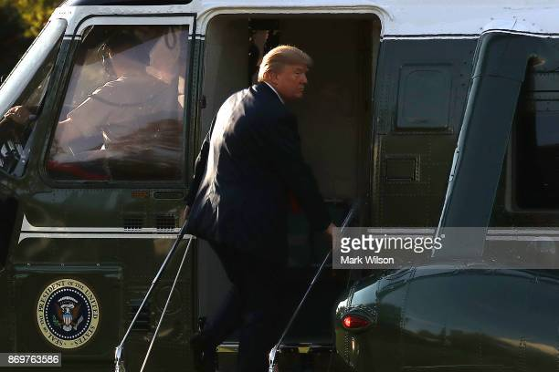 President Donald boards Marine One while departing from the White House on November 3 2017 in Washington DC President Trump is embarking on a five...