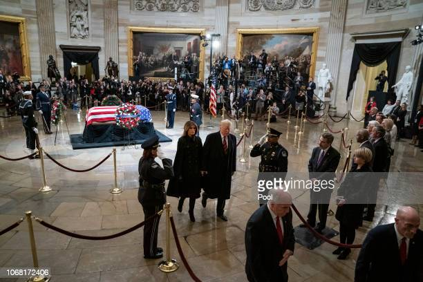 President Donald J Trump and first lady Melania Trump depart after paying their respects to former US President George HW Bush lies in state in the...