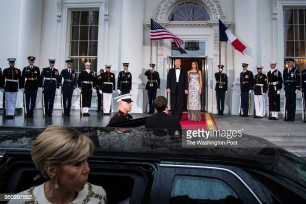 President Donald J Trump and first lady Melania Trump greet French President Emmanuel Macron and his wife Brigitte Macron at the North Portico as the...