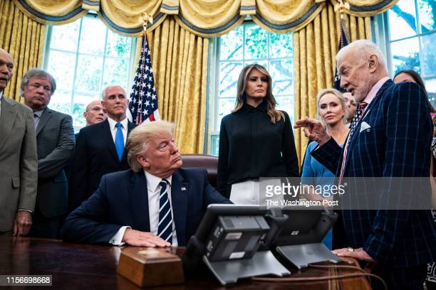 President Donald J Trump and First Lady Melania Trump meet with Buzz Aldrin Michael Collins and the Family of Neil Armstrong in celebration of the...