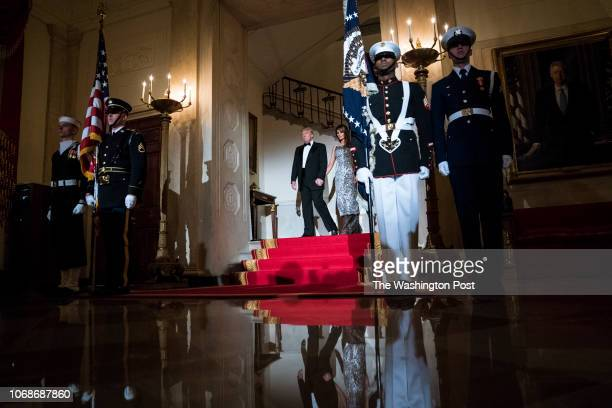 President Donald J Trump and first lady Melania Trump walk out with French President Emmanuel Macron and his wife Brigitte Macron in the Grand Foyer...