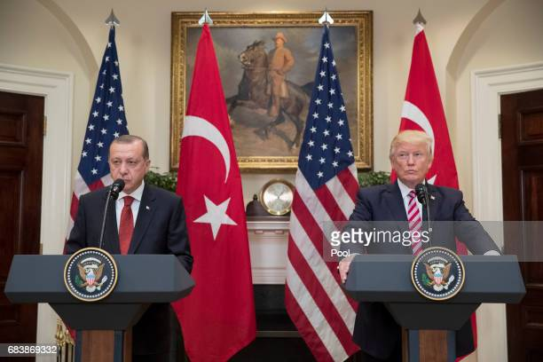 US President Donald J Trump and President of Turkey Recep Tayyip Erdogan deliver joint statements in the Roosevelt Room of the White House on May 16...