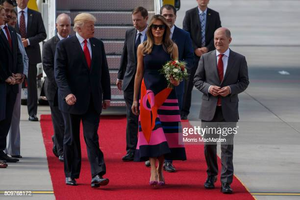 S President Donald J Trump and the first lady Melania Trump are welcomed by Hamburg's Mayor Olaf Scholz as they arrive at Hamburg Airport for the...