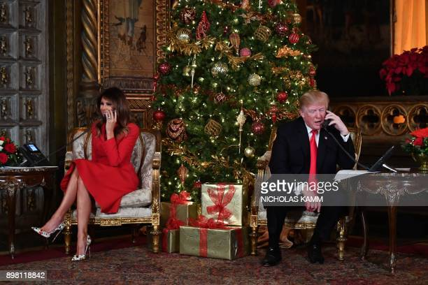 President Donald J Trump and the First Lady Melania Trump participate in NORAD Santa Tracker phone calls at the MaraLago resort in Palm Beach Florida...