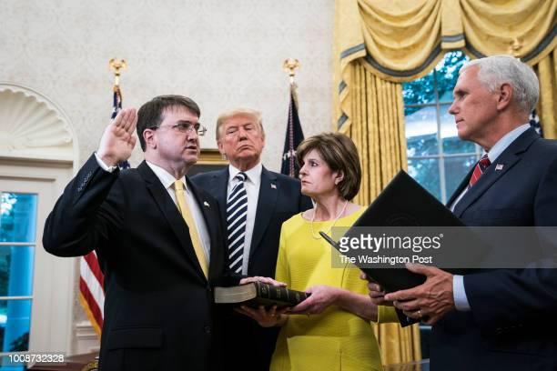 President Donald J Trump and Vice President Mike Pence take part in a swearingin ceremony for the new Secretary of the Department of Veterans Affairs...