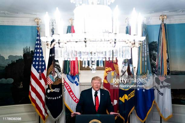 President Donald J. Trump announces the death of founder and leader of ISIS Abu Bakr al-Baghdadi, from the Diplomatic Reception room at the White...
